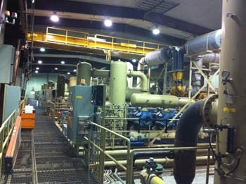 Capturing waste heat in compressor room